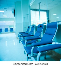row of chairs in a infusion room of hospital.