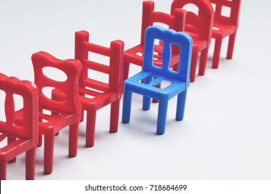 Row of chairs with one odd one out. Job opportunity. Business leadership. recruitment concept.