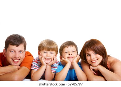 Row of cheerful family members lying and looking at camera with smiles