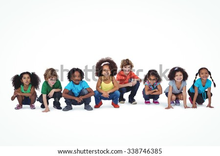 A row of children crouching down together against a white background