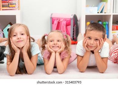 Row of children on floor in classroom