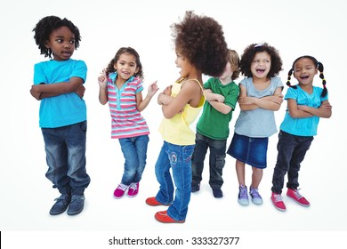 A row of children standing together with crossed arms against a white background