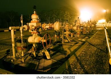 row of christmas tree valves on an oil well in the Ecuadorian Amazon