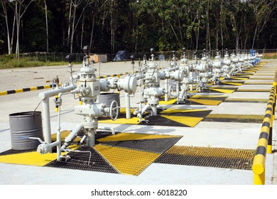 Row of Christmas tree valves on an Amazonian oil well