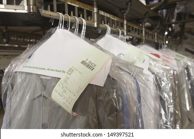 Row of clean clothes on hanger in laundry