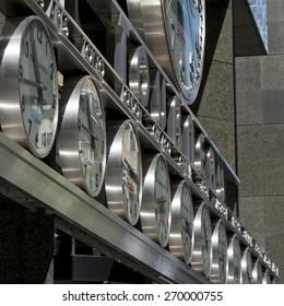Row of Clocks on building, Manhattan, New York City, New York State, USA
