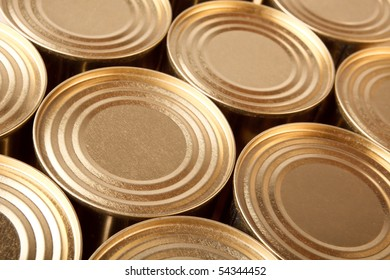 Row of the closed metal cans of yellow colour. Diagonal top view.