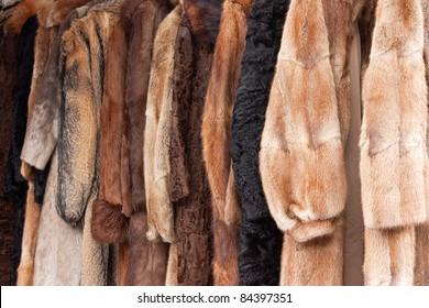 Row of coats made of animal fur.