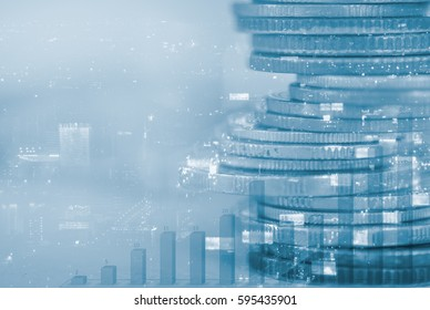 Row of coins with night city background and column diagram, Finance and banking background concept