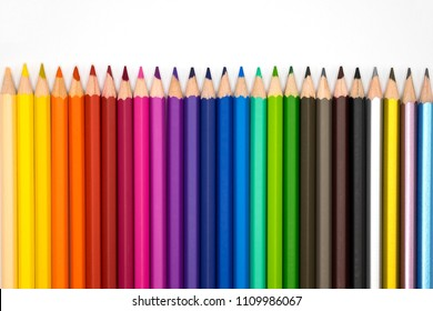 row color pencils on white background