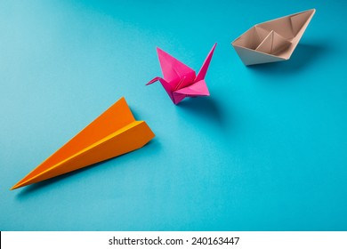 row of colored paper origami plane crane, boat