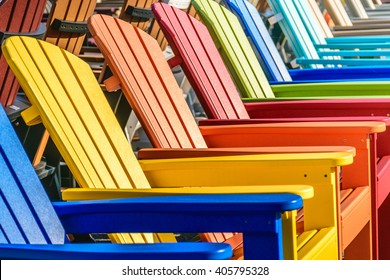 A row of colorful adirondack chairs