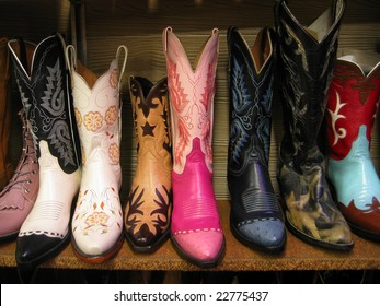 Row of colorful boots on shelf.