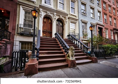 a row of colorful brownstone buildings with gas lamp post