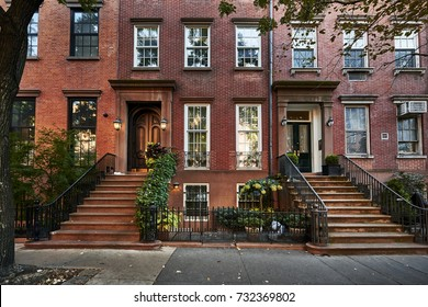 a row of colorful brownstone buildings in a historic neighborhood of Brooklyn in New York City
