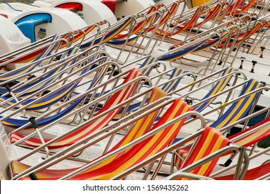 Row of colorful chaise longue on beach