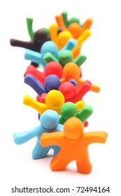 row of colorful and cheerful plasticine people