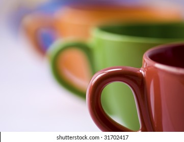 Row of colorful coffee cups with a small depth of field