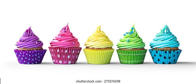 Row of colorful cupcakes isolated on a white background