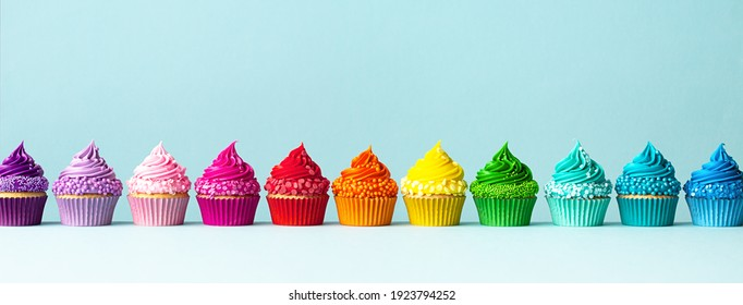 Row of colorful cupcakes in rainbow colors