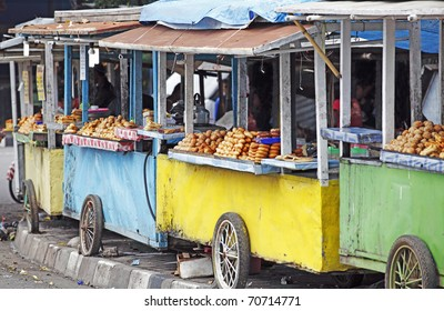 Row of colorful exotic street food vendor along the street to the Sultan Palace in Jogjakarta city.