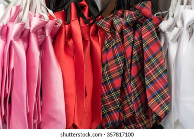 row of colorful kid's neck tie