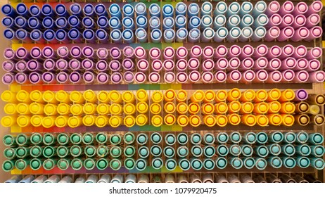 Row of colorful pen cap in store shelf for display and sale. - Shutterstock ID 1079920475