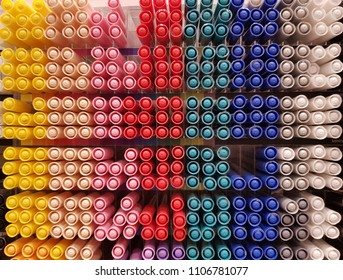 Row of colorful pen cap in store shelf display for sale. Pen cap pattern for background.