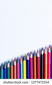 A row of Colorful Pencils showing an increasing graph