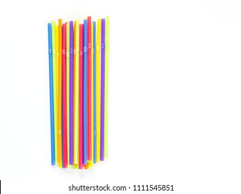 a row of colorful plastic flexible straws isolated on white
