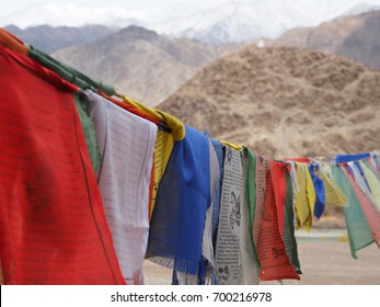 A row of colorful prayer flags at Ladakh, India