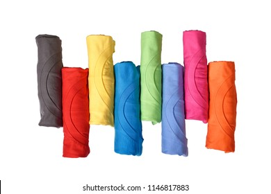 Row of colorful rolled clothes isolated over white background