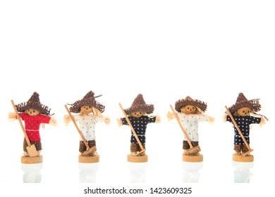 Row colorful scarecrows isolated over white background