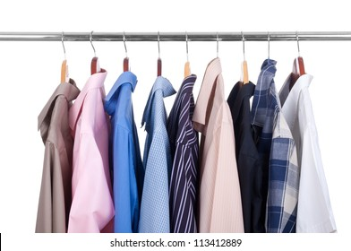 row of colorful row shirts hanging on hangers on a white background