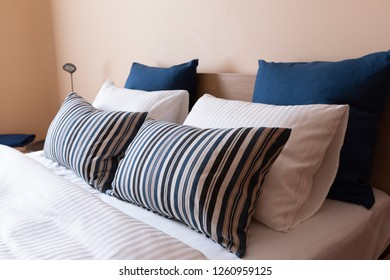 A row of comfortable pillows of a prepared bed