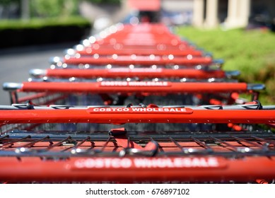 A row of Costco Wholesale shopping carts in Costco's parking lot. Port Chester, New York, Westchester County, USA on June 26, 2017.