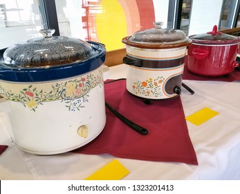 row of crock pots in restaurant chili cook off competition
