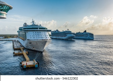 Row of Cruise Ships in the Caribbean tied to the docks at sunset