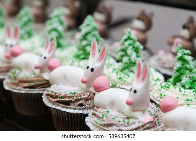 Row of cupcakes with bunnies on top and selective focus
