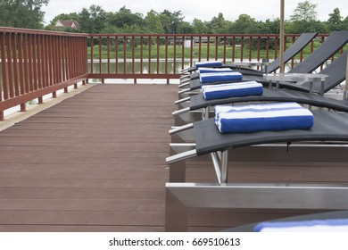 row of daybeds by the pool