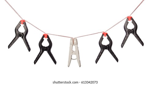 Row of different color plastic clips on the rope isolated on white background. Teamwork, collectivity, leadership, independence, initiative, business success concept.