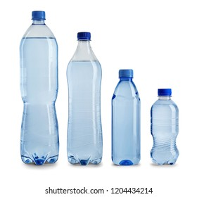 Row of different plastic bottles with water on white background
