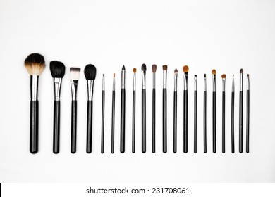 A row of different size makeup brushes