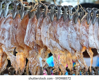 Row of dried squid on street market, Thailand, selected focus