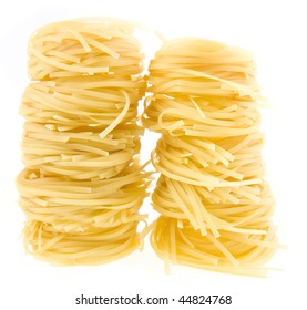 row dry nest pasta on white  background