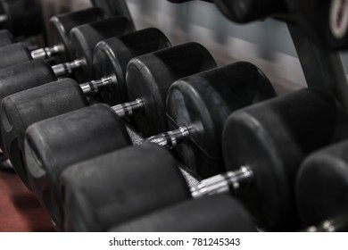 Row of dumbbells in a gym