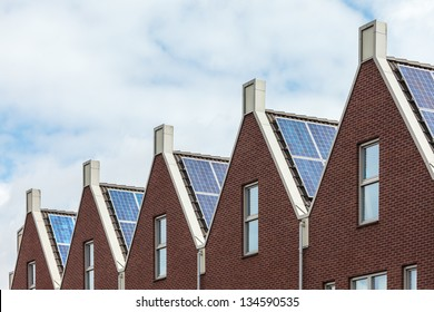 Row of Dutch new houses with solar panels