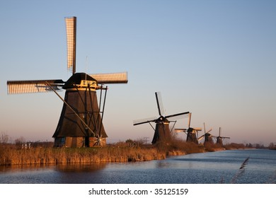 Row of Dutch Windmills in evening light