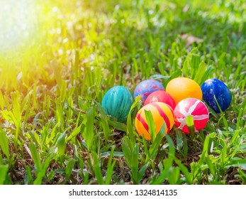 Row of Easter eggs in Fresh Green Grass.