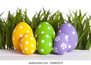 Row of Easter eggs in Fresh Green Grass. studio shot